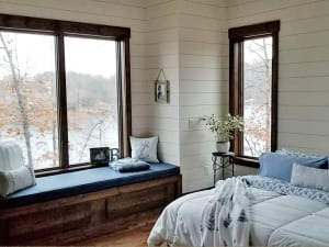 lake home bedroom decorated in blue and white color scheme